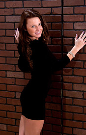 Busty Brunette Kendra In A Tight Black Dress And Heels Showing Off Her Teen Tits - Picture 1