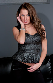 Big Titted Teen In Tight Black Pants Fondles Her Coochie On The Couch - Picture 1