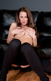 Big Titted Teen In Tight Black Pants Fondles Her Coochie On The Couch - Picture 10