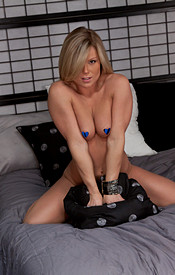 Madden Lookin Sexy In Her Purple Corset And Thong Straddled On The Bed - Picture 13