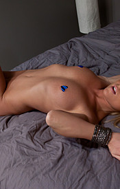 Madden Lookin Sexy In Her Purple Corset And Thong Straddled On The Bed - Picture 14