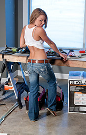 Meet Madden Doing Some Construction In A White Tank Top And Jeans - Picture 2