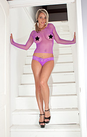 Busty Nikki Sims In Purple Mesh And Thong Showing Lots Of Leg And Lots Of Boob - Picture 1