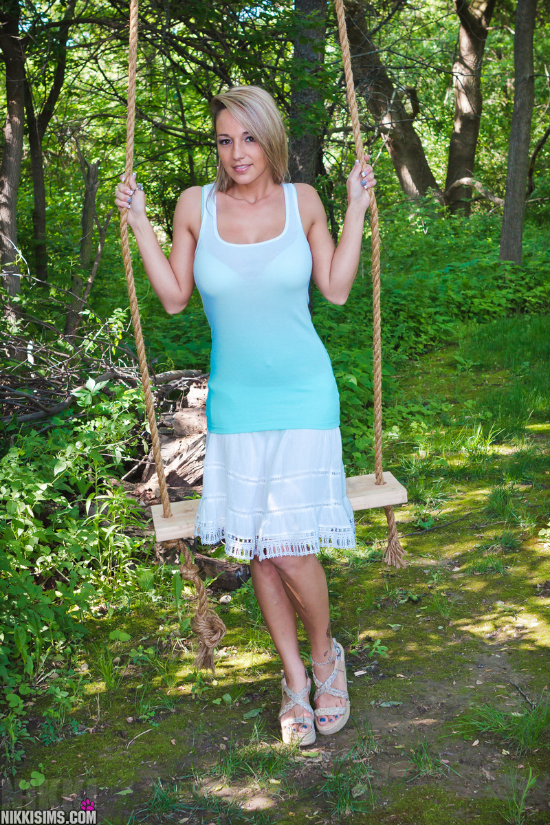 Nikki Sims Having Some Fun On The Swing And Getting Naked - Picture 1